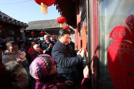 习近平春节前夕在北京看望慰问基层干部群众向广大干部群众致以美好的新春祝福祝各族人民幸福安康祝伟大祖国繁荣吉祥